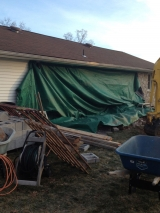 <h5>A Contractors Tale</h5><p>Tarp cover rear of house after removal of stone.</p>