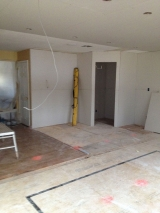 <h5>A Contractors Tale</h5><p>Pantry and TV cabinet area with drywall.</p>